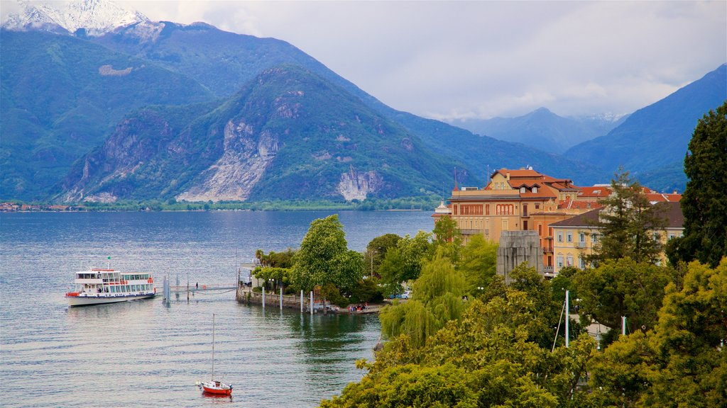 Villa Giulia featuring a lake or waterhole, a small town or village and mountains