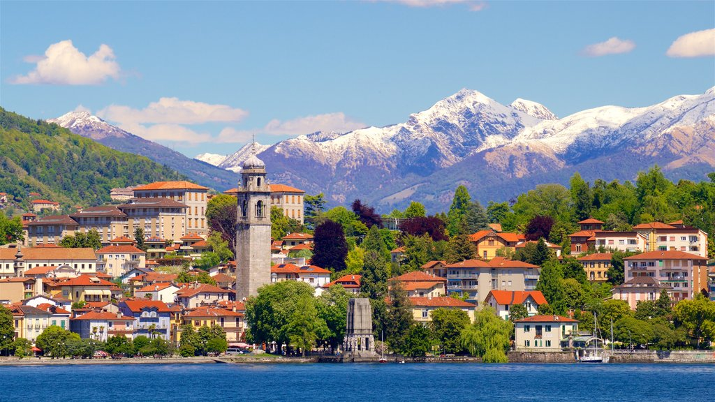 Verbania showing a lake or waterhole, mountains and a small town or village