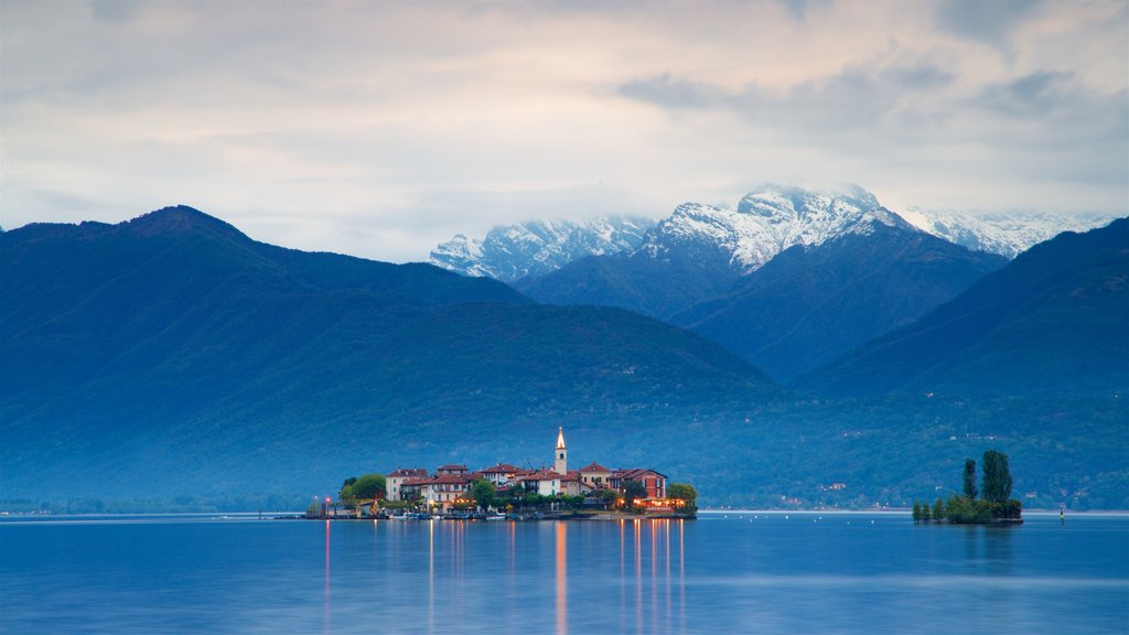 Isola dei Pescatori which includes a lake or waterhole, a small town or village and mountains