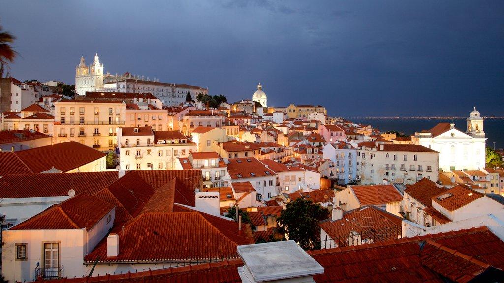 Miradouro de Santa Luzia featuring night scenes, a city and a coastal town