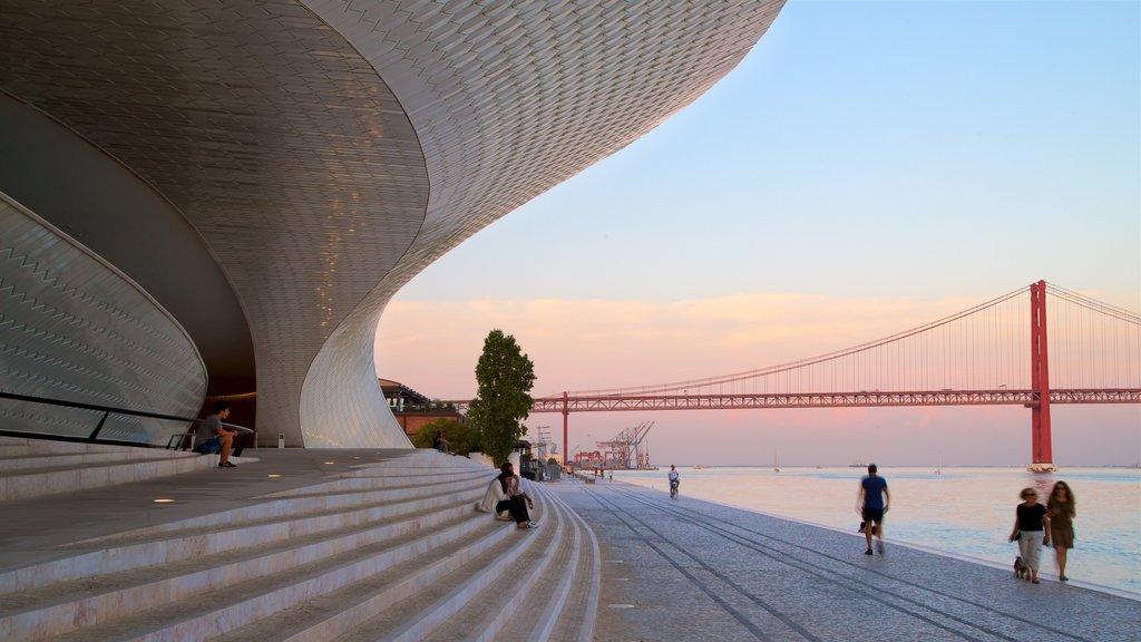 Lisbon District showing modern architecture, a sunset and a bridge