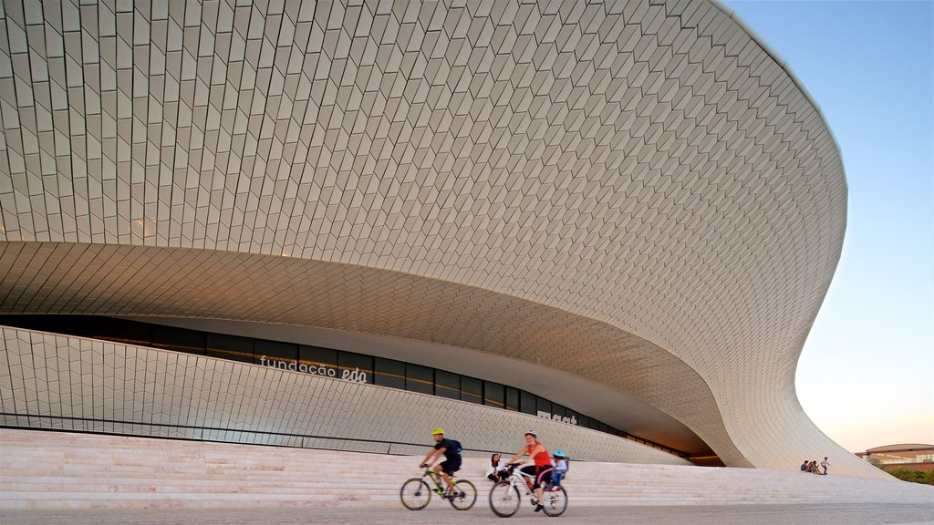 Lisbon District which includes modern architecture, a sunset and cycling