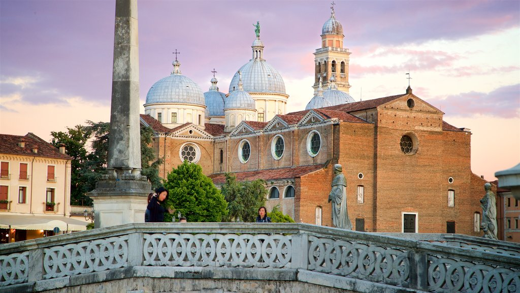 Prato della Valle featuring heritage architecture, a church or cathedral and a sunset