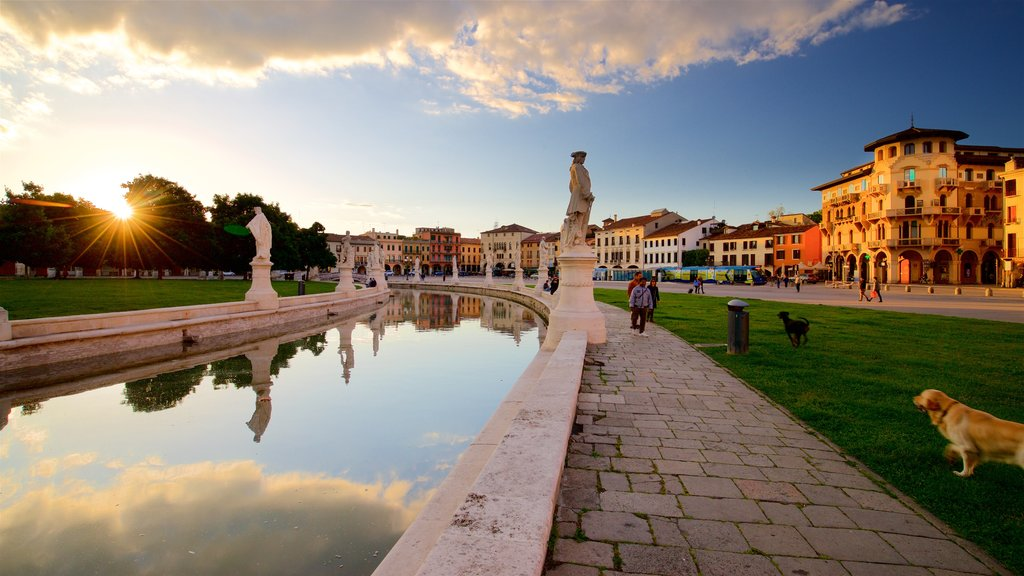 Prato della Valle showing a sunset, a river or creek and a statue or sculpture