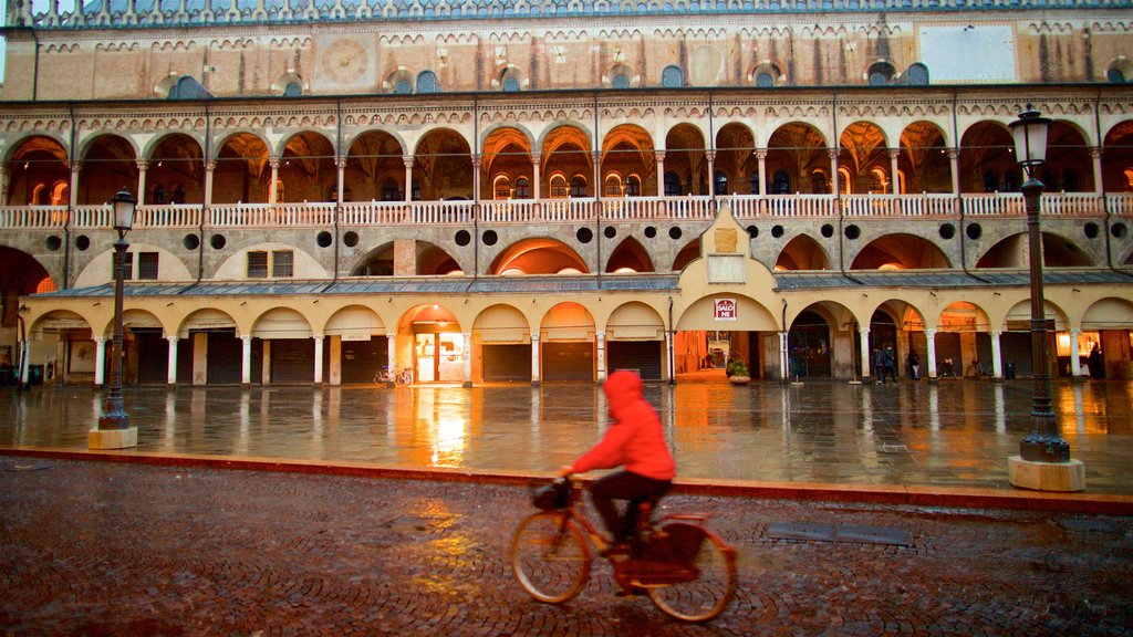 Piazza delle Erbe which includes heritage elements and road cycling