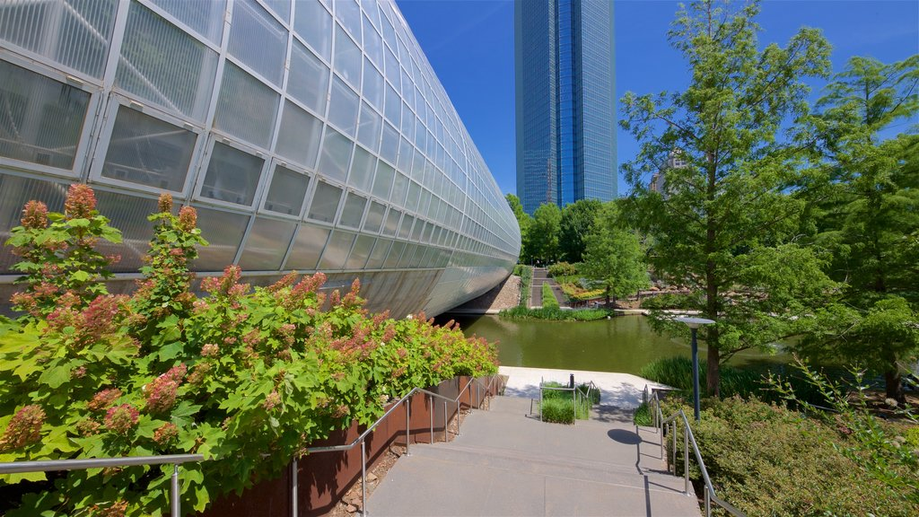 Myriad Botanical Gardens which includes a river or creek, modern architecture and a skyscraper