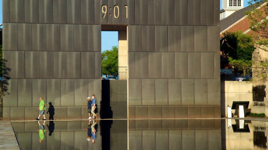 Oklahoma City National Memorial and Museum which includes modern architecture, street scenes and a pond