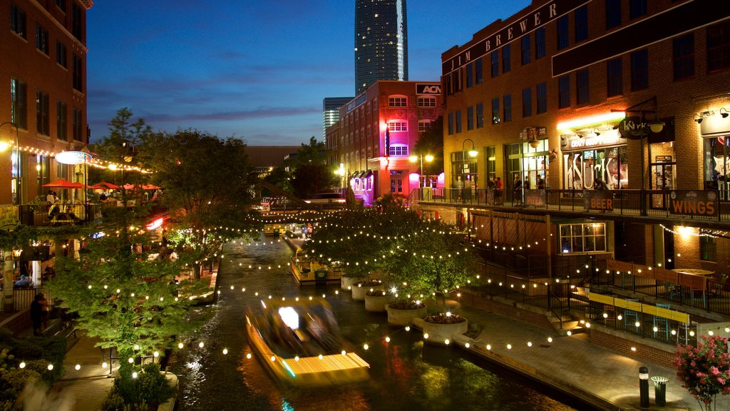 Bricktown showing a city, a river or creek and night scenes