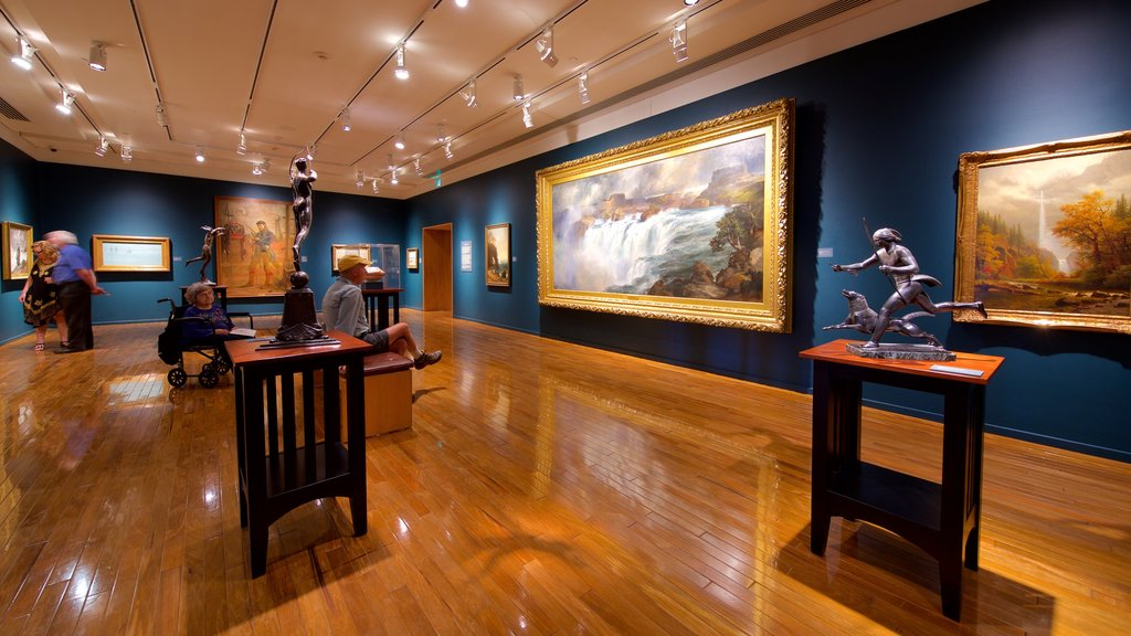 Gilcrease Museum featuring interior views and art as well as a small group of people