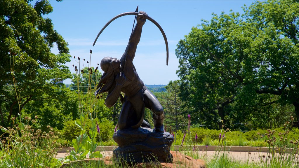 Gilcrease Museum showing a statue or sculpture and a garden