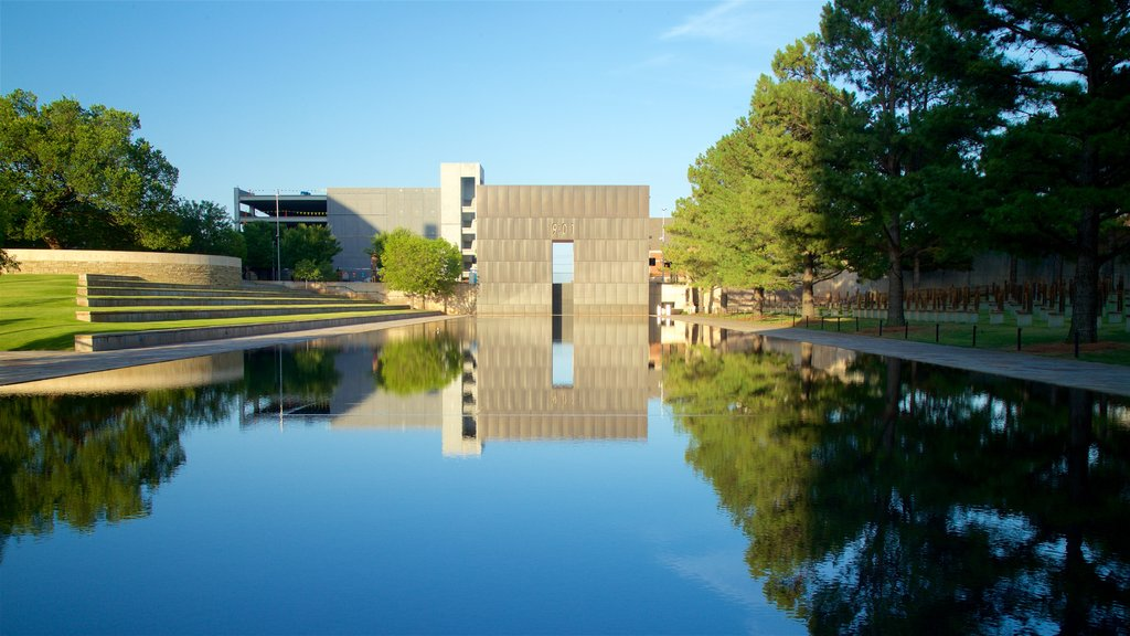Oklahoma City National Memorial and Museum featuring a park, a pond and heritage architecture
