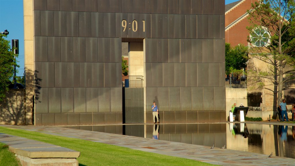 Oklahoma City National Memorial and Museum featuring a pond, a park and modern architecture