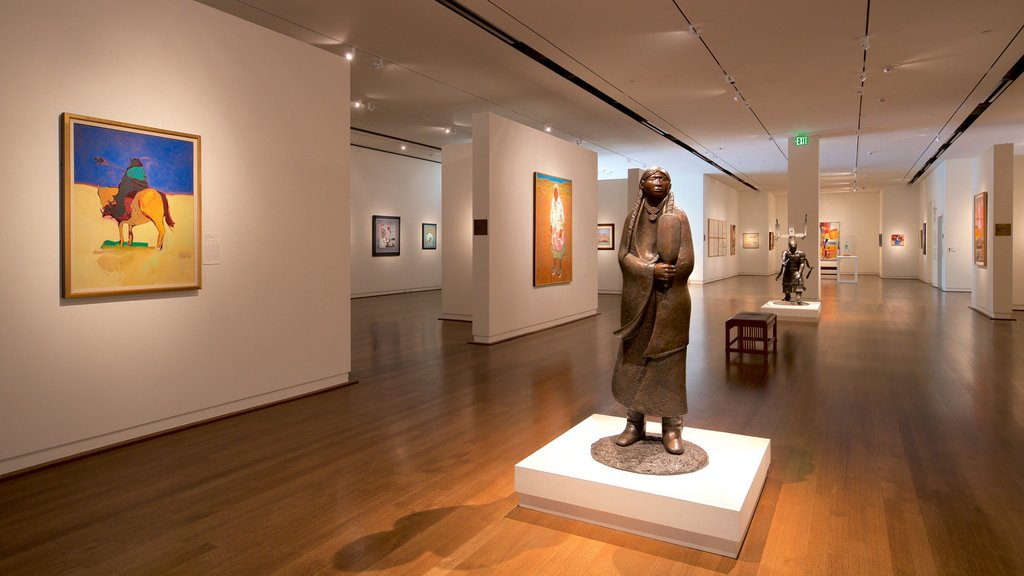 Fred Jones Jr. Museum of Art which includes art, a statue or sculpture and interior views