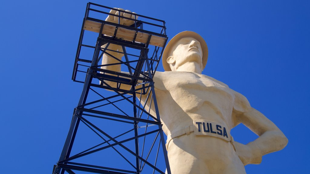 Golden Driller featuring outdoor art and a monument