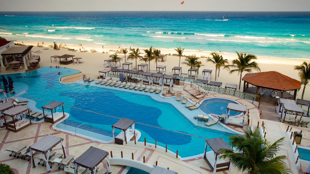 Cancun showing general coastal views, a pool and tropical scenes