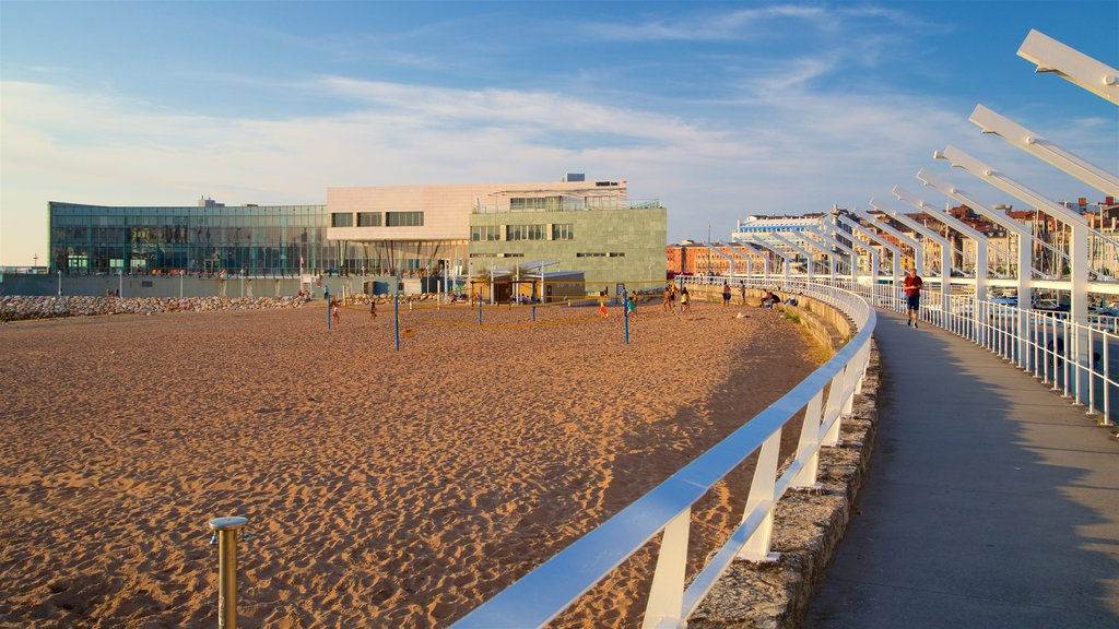 Talasoponiente featuring a sandy beach, a coastal town and a sunset