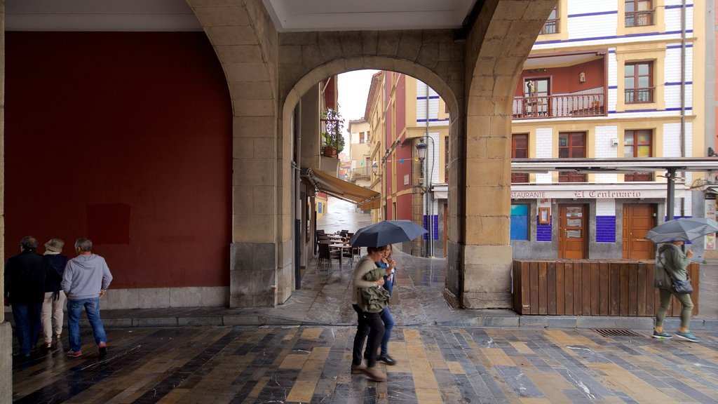 Plaza Mayor featuring heritage elements and street scenes as well as a small group of people