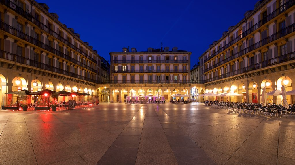 Plaza de La Constitucion which includes a square or plaza, night scenes and heritage elements