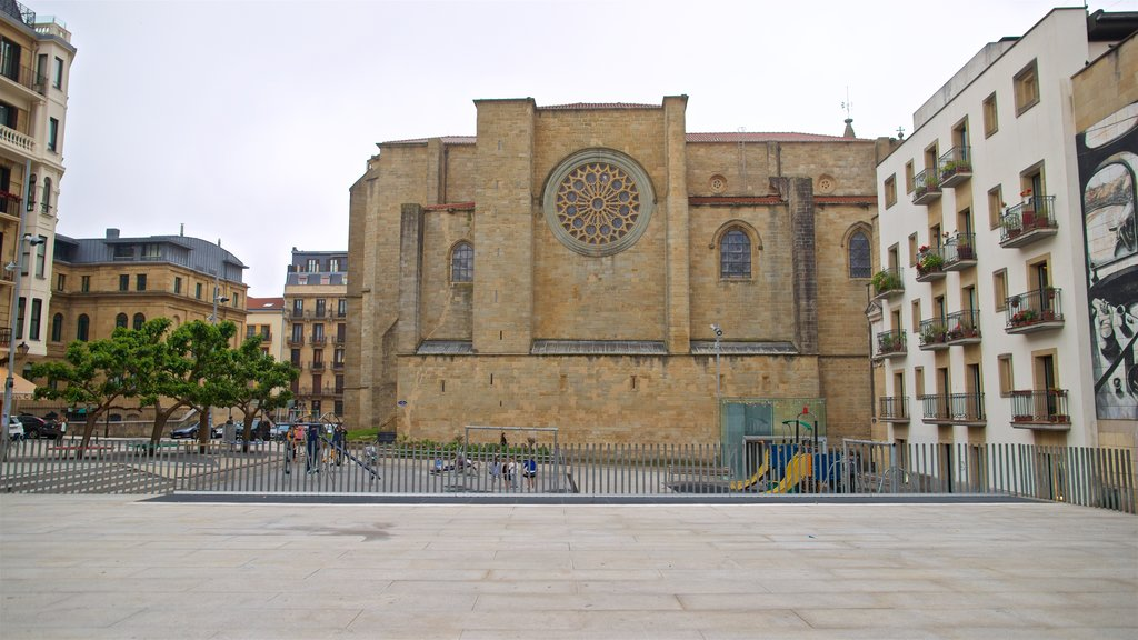 San Vicente Church which includes a square or plaza and heritage elements