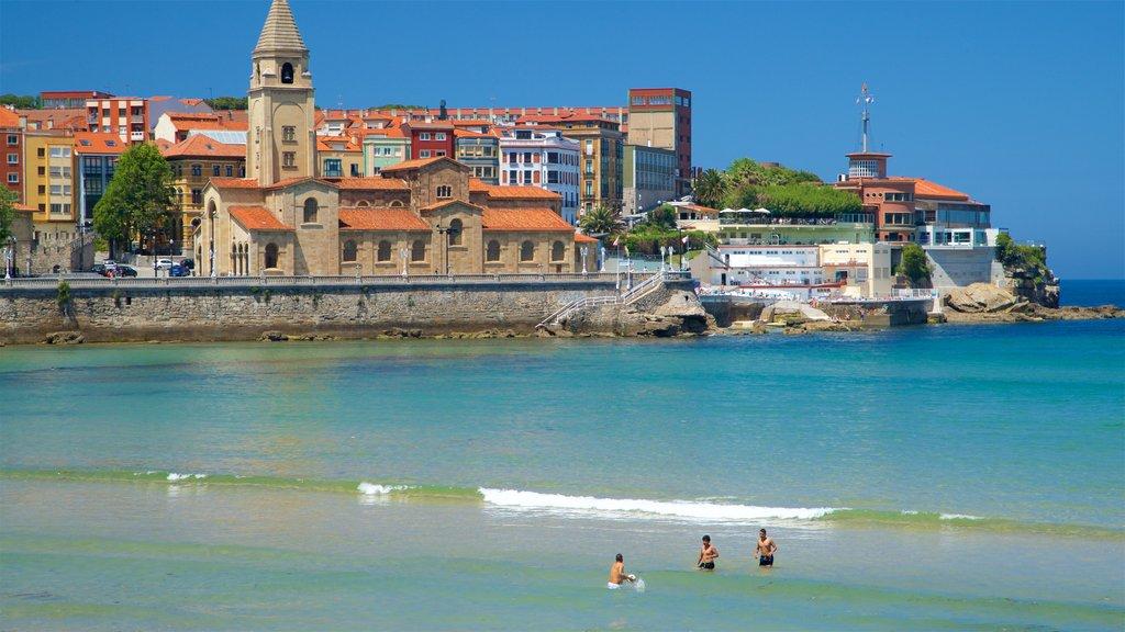 San Lorenzo Beach showing swimming, a coastal town and general coastal views