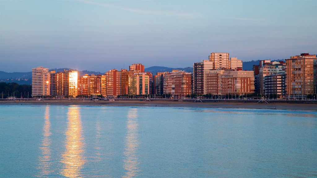 San Lorenzo Beach which includes general coastal views, a coastal town and a sunset