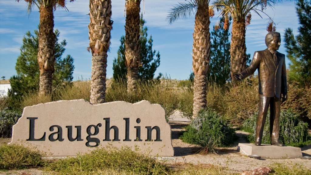 Laughlin showing a statue or sculpture, a monument and signage