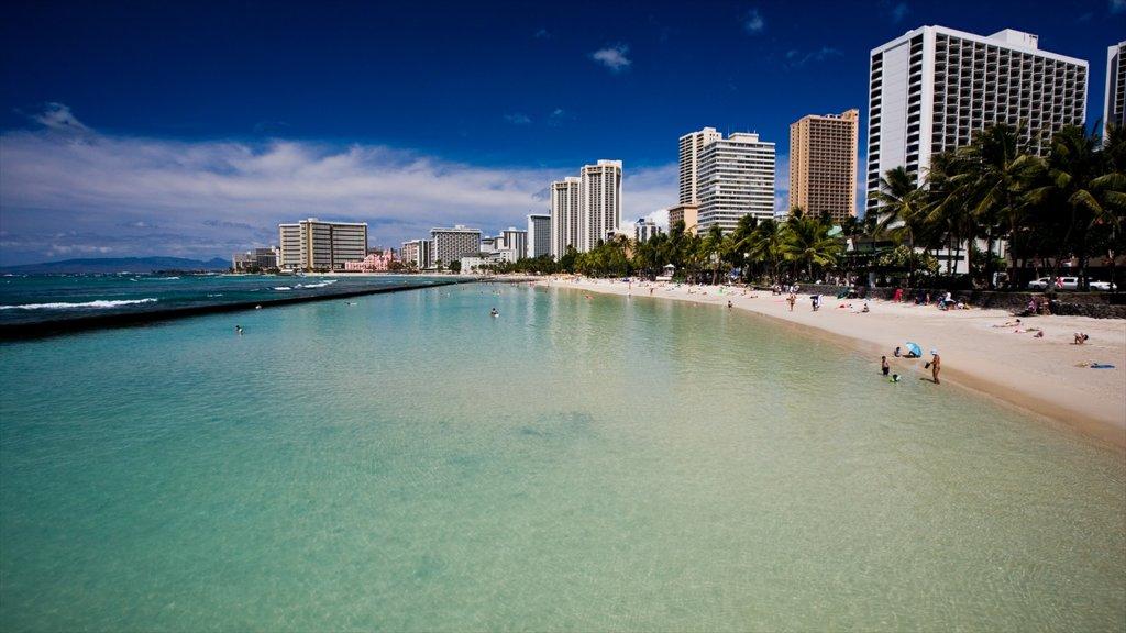 Waikiki which includes a beach, a coastal town and tropical scenes