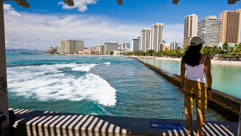 Waikiki showing a bay or harbor, general coastal views and a sandy beach
