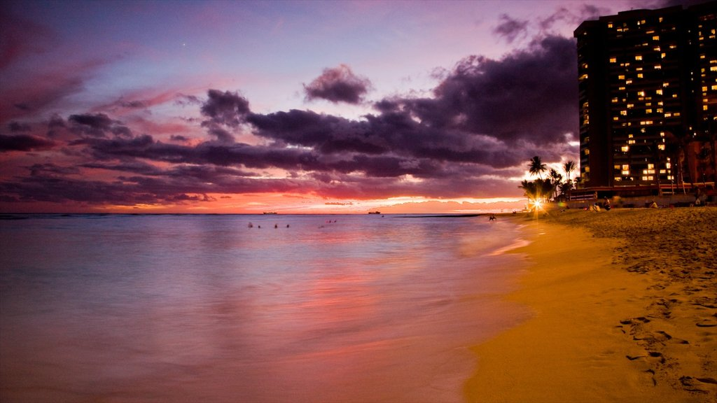 Waikiki which includes a sunset, a sandy beach and landscape views