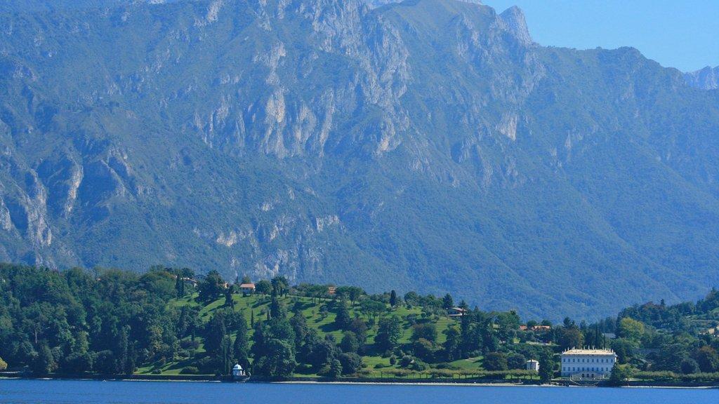 Como mostrando vistas de paisajes, un lago o abrevadero y montañas