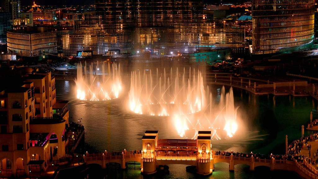 The Dubai Fountain featuring night scenes, a city and city views