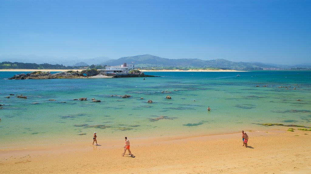 Magdalena Beach showing a beach and general coastal views as well as a small group of people