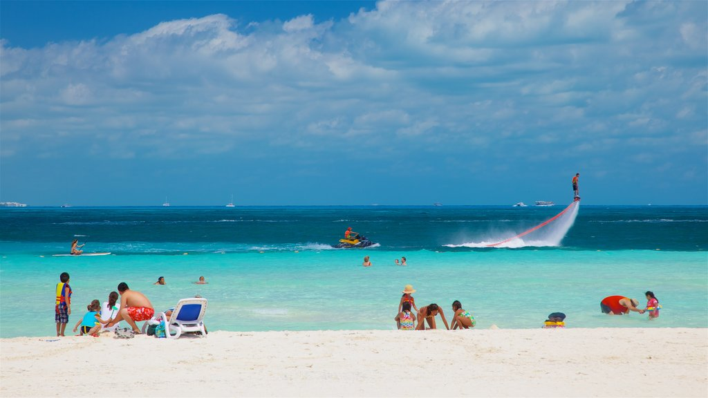 Cancun featuring a beach, watersports and tropical scenes