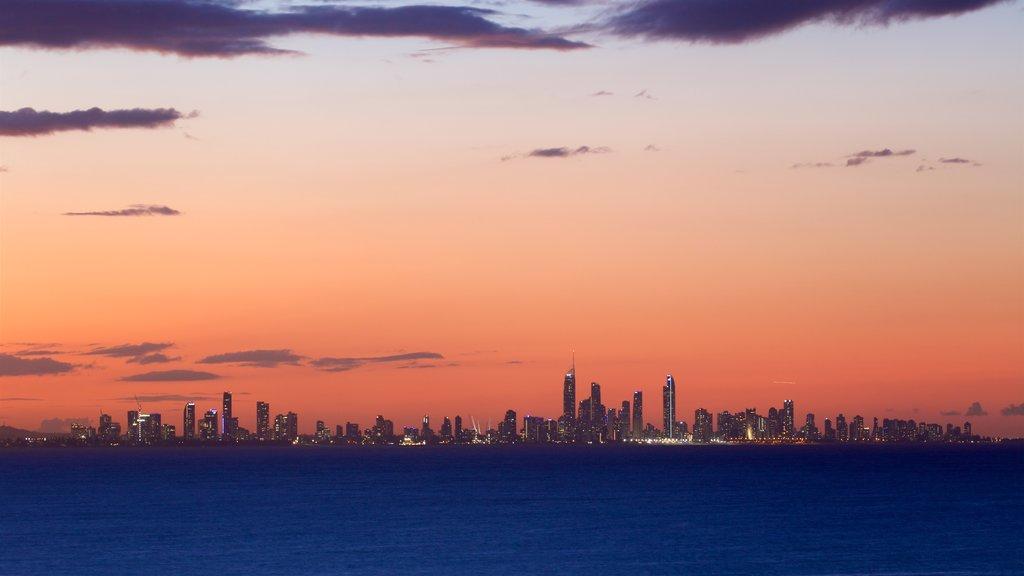 Coolangatta featuring a skyscraper, a sunset and a coastal town
