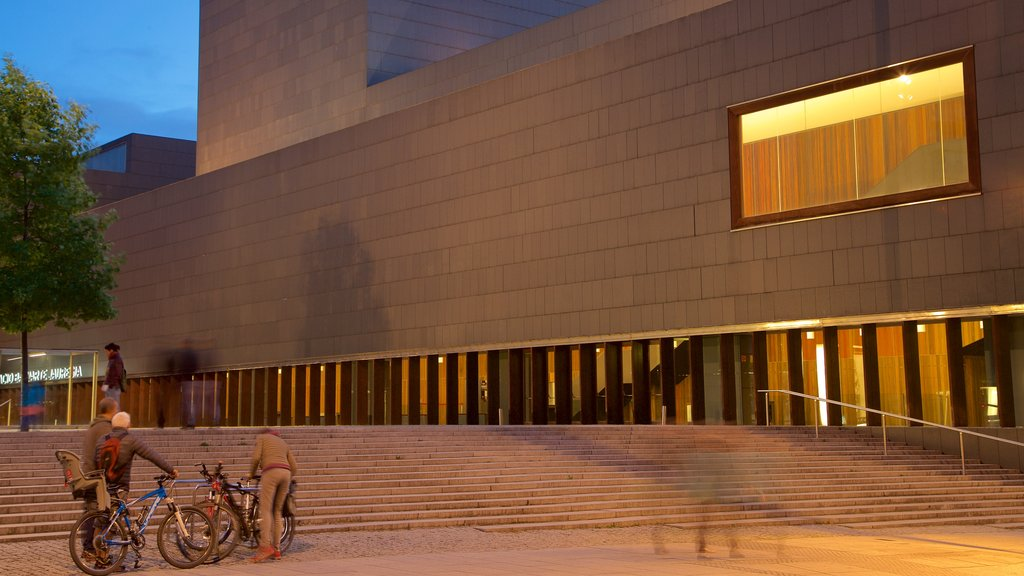 Palacio de Congresos and Auditorium of Navarra which includes street scenes and night scenes as well as a small group of people
