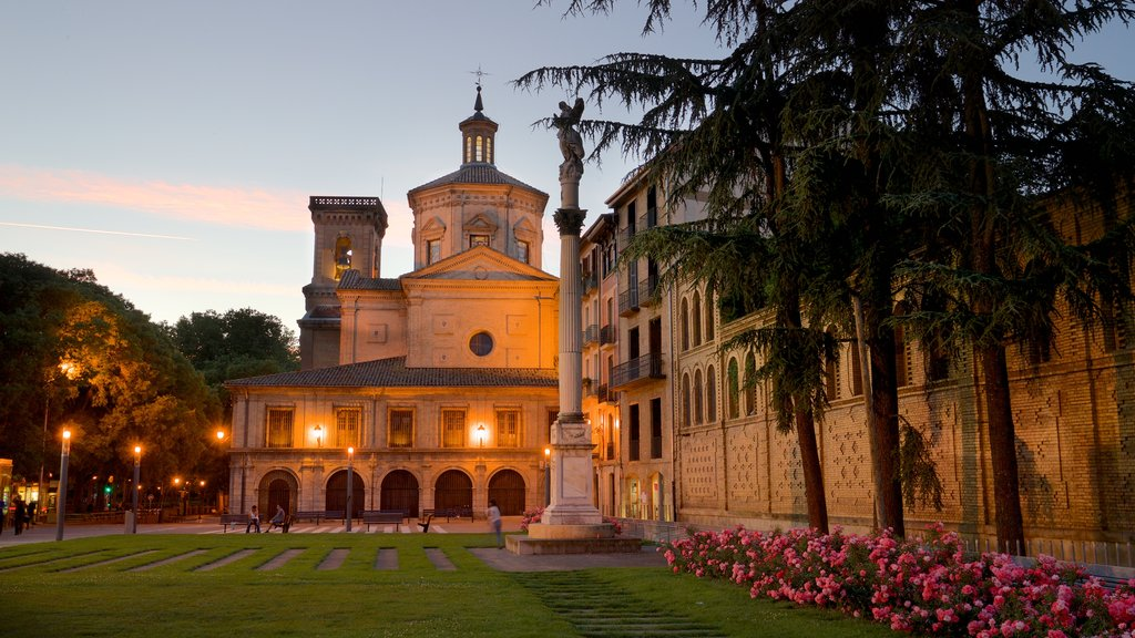 Parroquia San Lorenzo featuring a sunset, a garden and heritage architecture