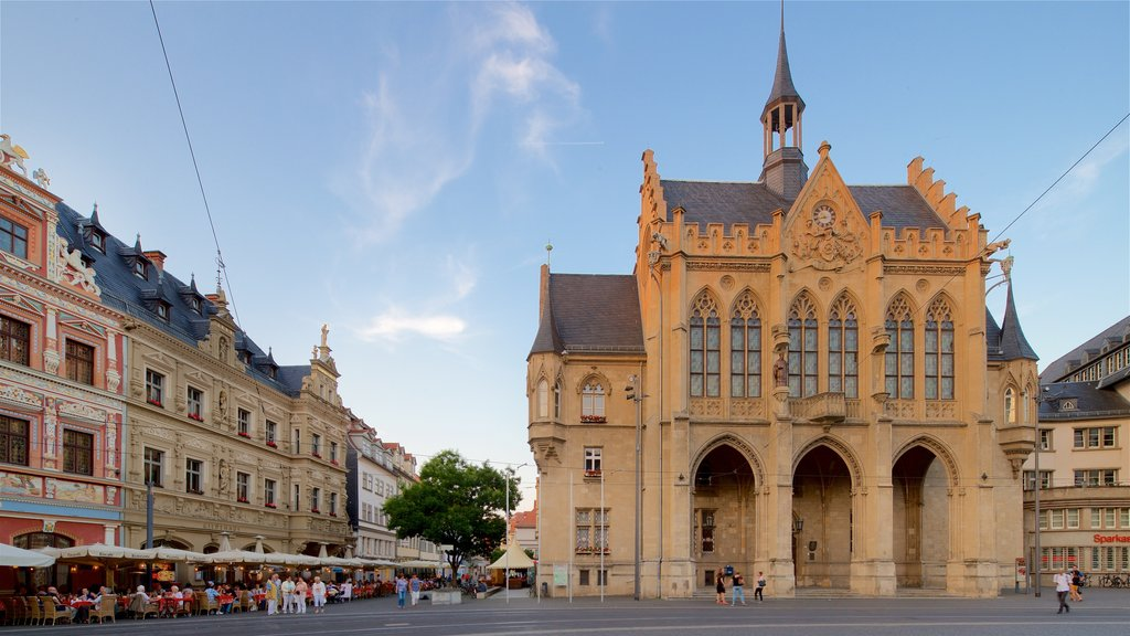 Rathaus showing heritage architecture, a sunset and a city