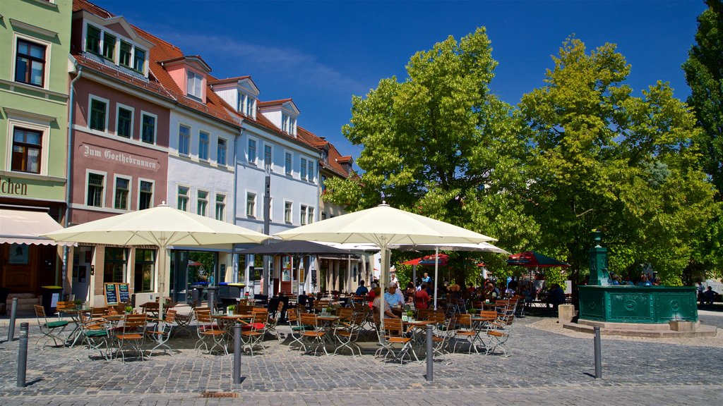 Weimar featuring outdoor eating as well as a small group of people