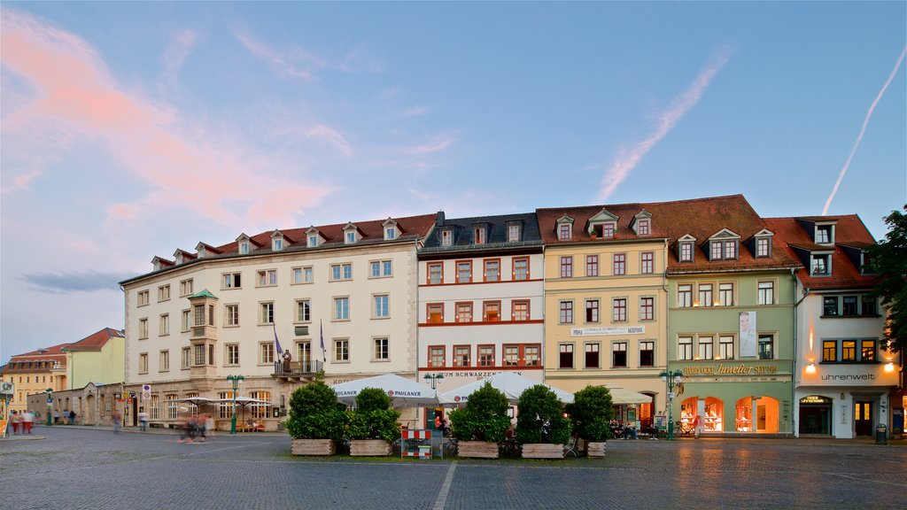 Weimar which includes a city, a sunset and heritage elements