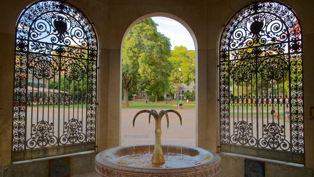 Kochbrunnen showing a garden, a fountain and interior views