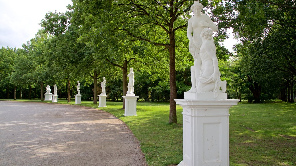 Karlsaue Park featuring a garden and a statue or sculpture