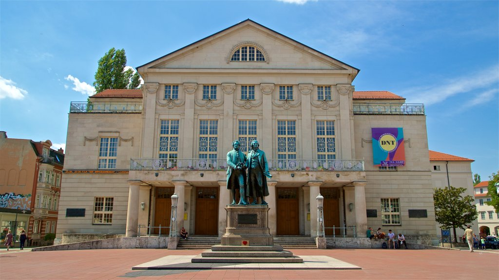 Goethe-Schiller Monument which includes a square or plaza, a statue or sculpture and heritage architecture