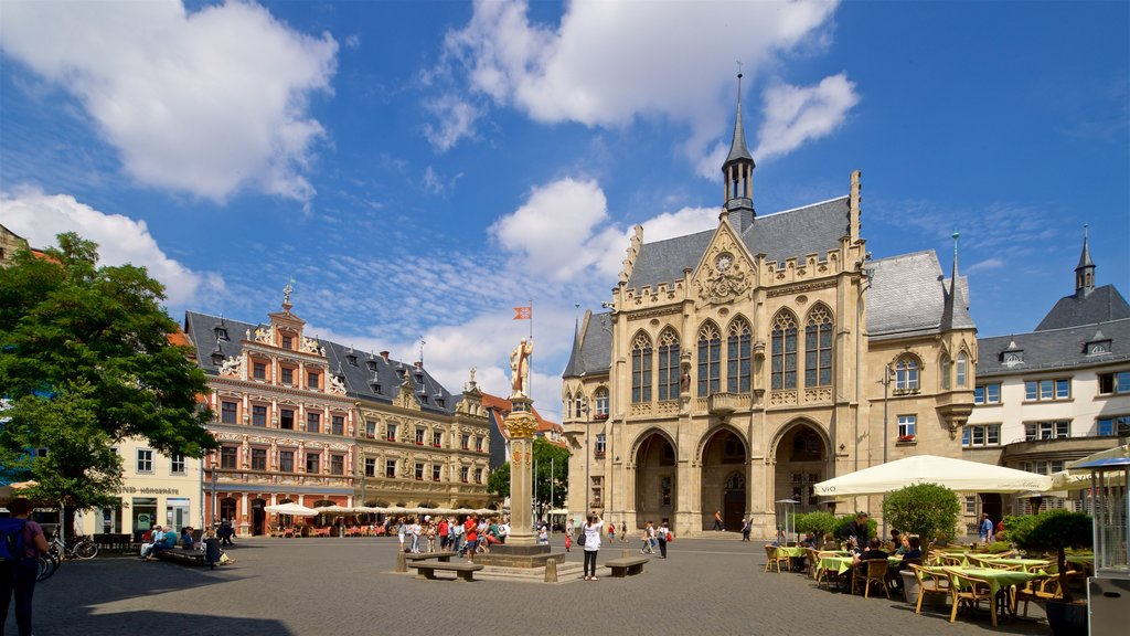 Rathaus which includes a statue or sculpture, heritage architecture and street scenes