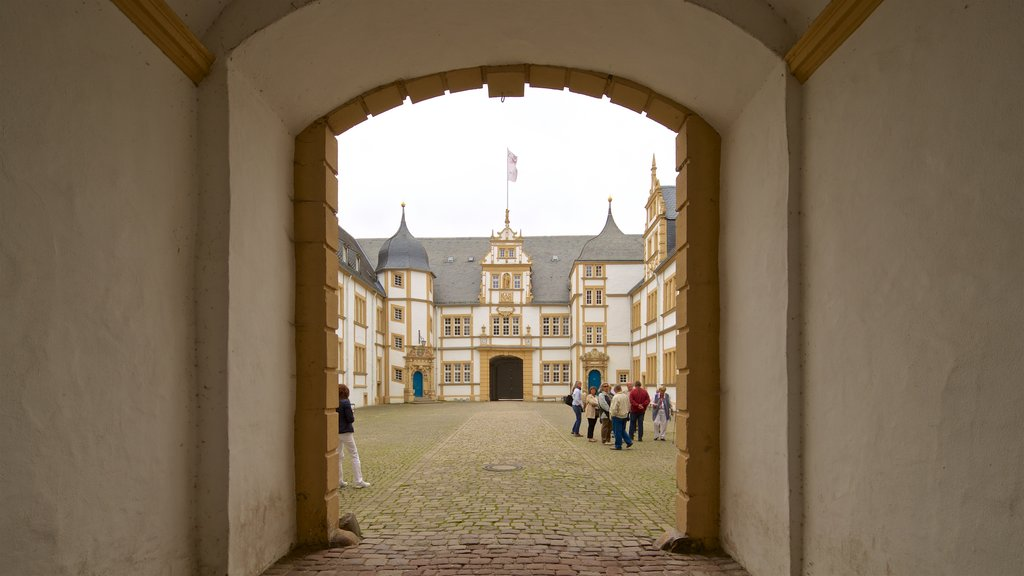 Neuhaus Castle which includes street scenes, heritage architecture and interior views