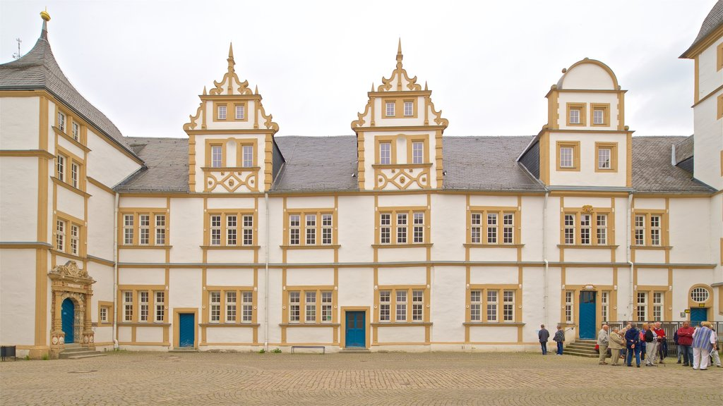 Neuhaus Castle which includes heritage architecture and street scenes as well as a small group of people