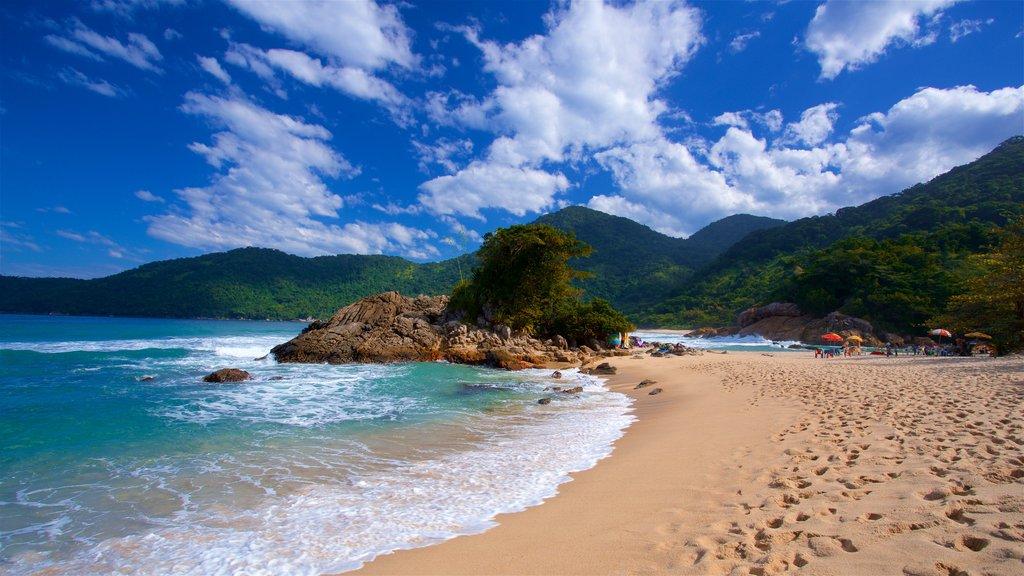 Meio Beach showing rugged coastline, a sandy beach and general coastal views