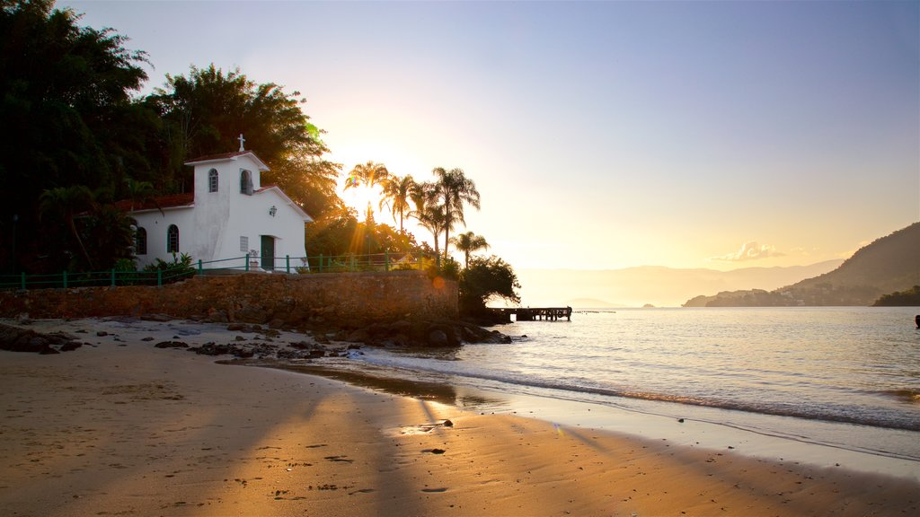 Gipoia Island featuring a beach, a church or cathedral and a sunset