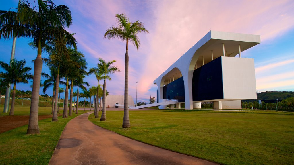 Belo Horizonte which includes modern architecture, a garden and a sunset