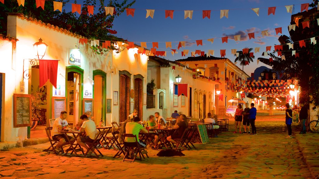 Paraty showing outdoor eating and night scenes as well as a small group of people