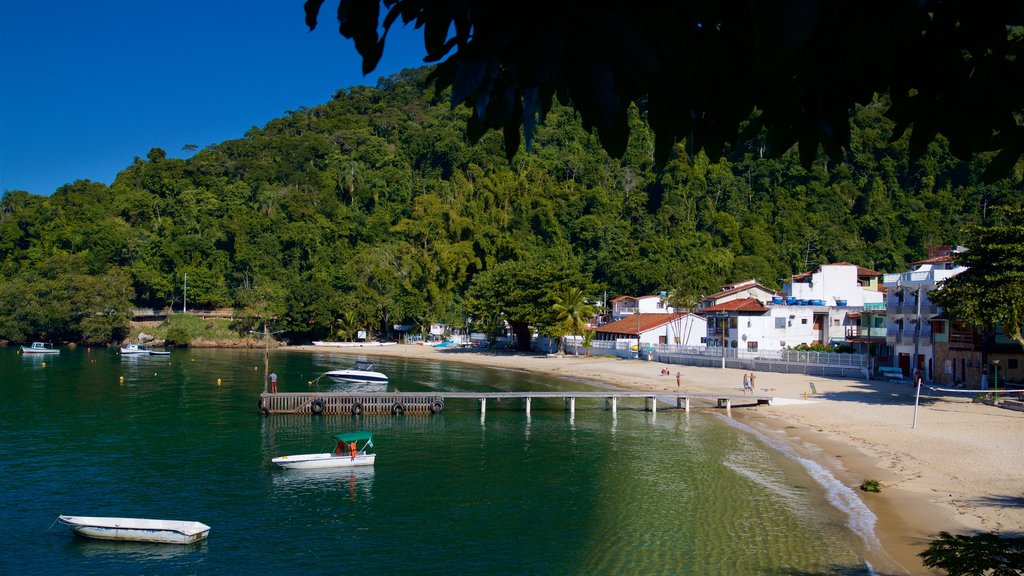 Bonfim Beach showing a coastal town, a bay or harbor and a sandy beach